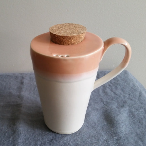 Travel mug in Coral Glaze by Muddy Marvels Handmade Pottery Squamish