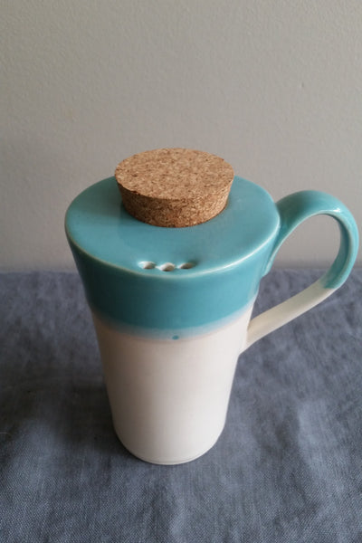 Travel mug in Teal glaze by Muddy Marvels Handmade Pottery Squamish