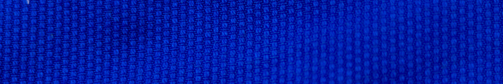 Close up of a blue pearl weave cotton fabric