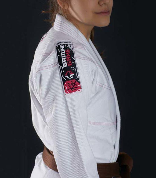 Side view of a Ground Game Sakura BJJ Women`s Gi White