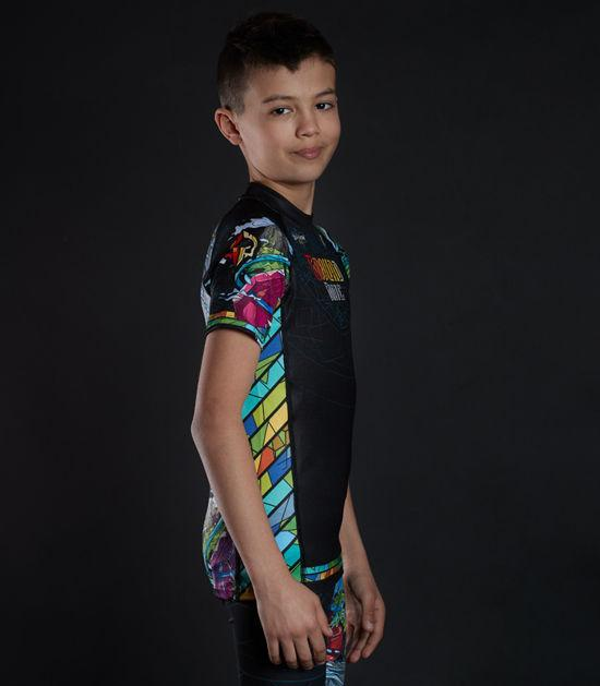 Side view of a Ground Game Carioca Kids Rashguard