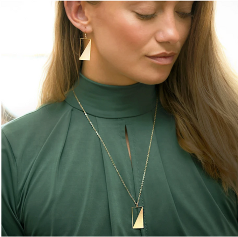 A model wears Geometric Earrings and Necklaces by Rael Cohen Jewelry