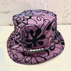 CADRE Bucket Hat: Purple iridescent with floral pattern