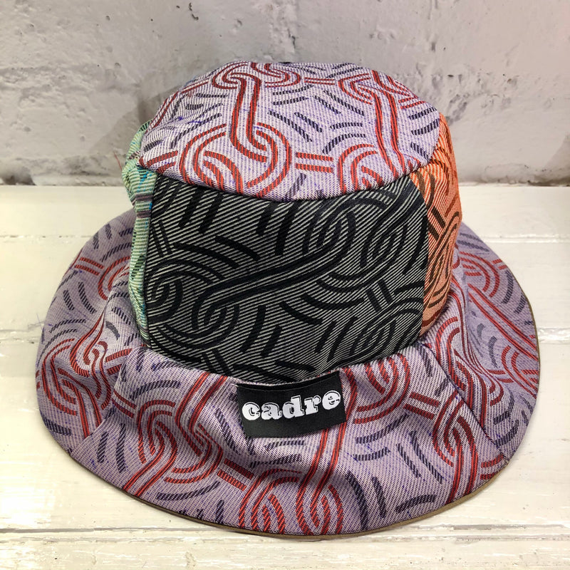 CADRE Bucket Hat: Patterned lines and shapes