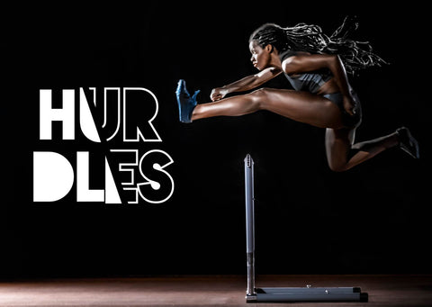 woman going over hurdles