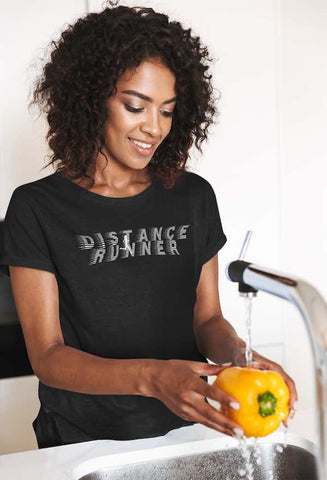 t-shirt of. happy woman washing a bell pepper