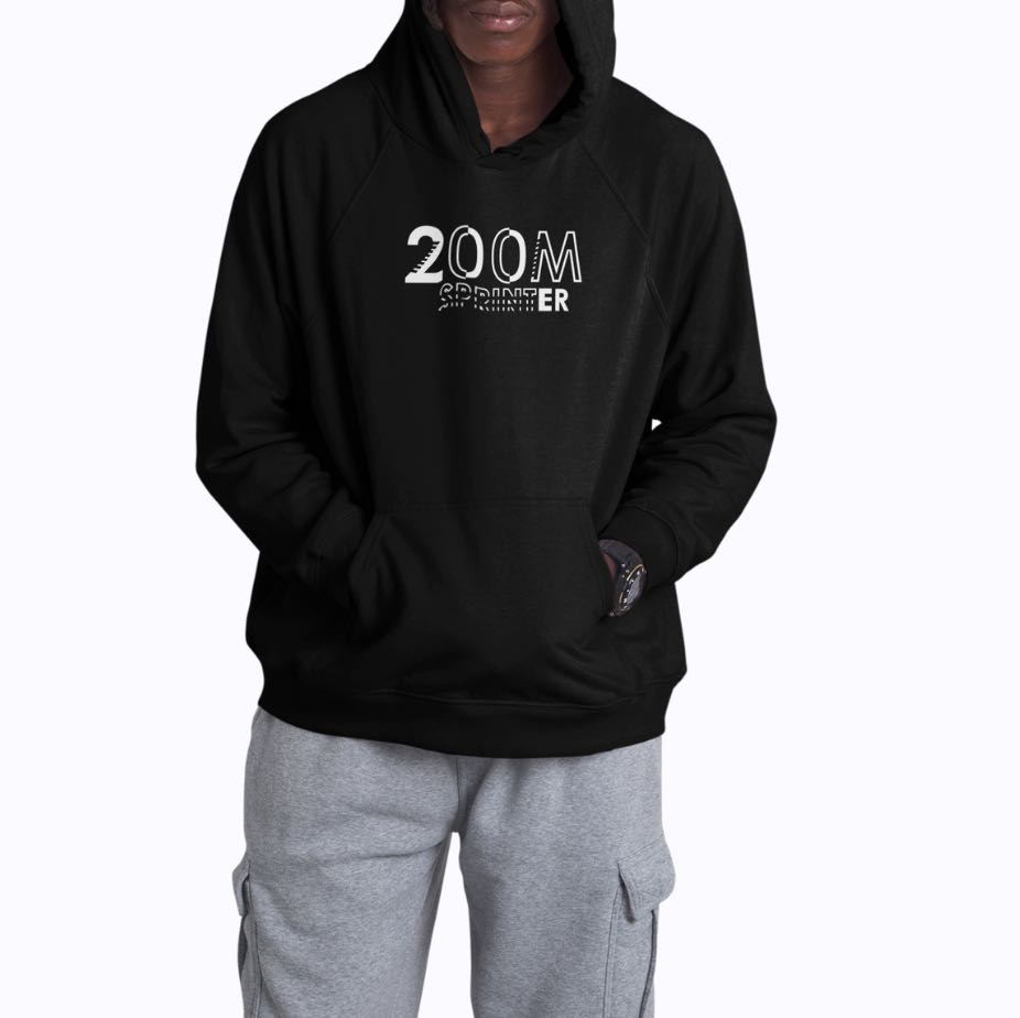African American Male wearing a Black Hoodie standing on a plain background