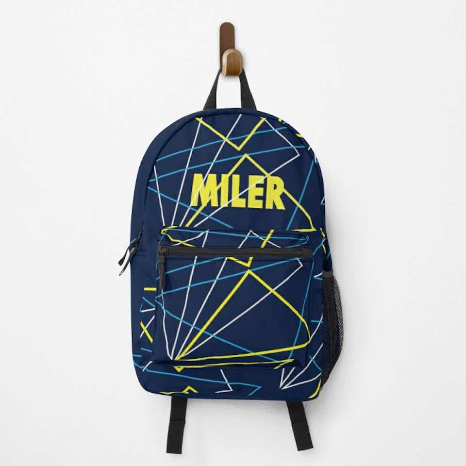 Athletic backpack mockup with a miler design hanging on a peg