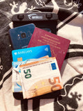 Phone, passports, cards and cash all fit in a Swymbag