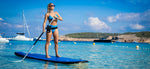 Paddle boarder with swymbag waterproof bag / mobile phone case around waist
