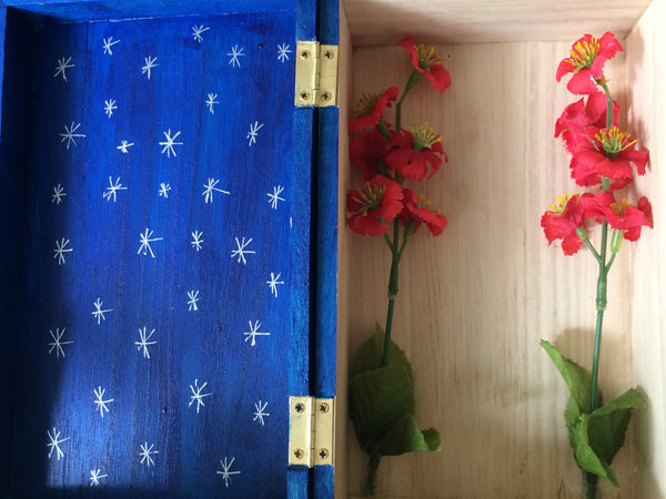 Hand-painted wooden shrine box, dark blue with silver stars, red flowers