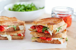 Ready to try a new kind of grilled cheese? This Grilled Cheese with Mozzarella, Roasted Red Peppers, and Arugula is sweet, peppery, and too tempting to pass up!