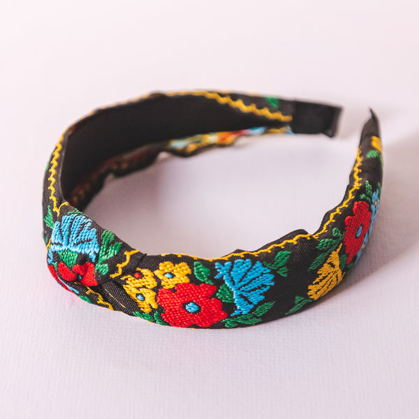 Knotted black embroidered flower headband with red yellow blue and green