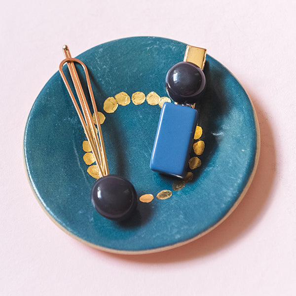 Blue & navy blue hair pin and clip with gold. Round bobble clip and pin that can be put in your hair to accessorize your outfit.