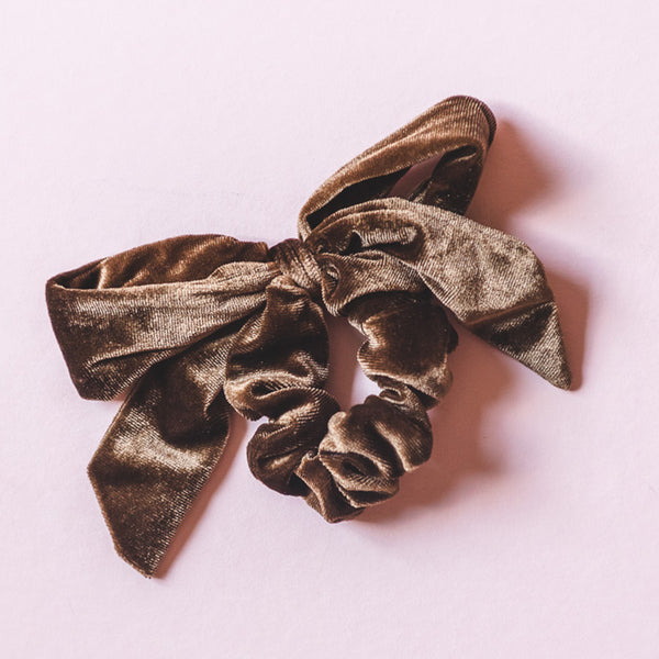 Velvet has taken the fashion world by storm once again! This brown velvet bow scrunchie is the perfect way to add a vintage vibe to your outfit in 2 seconds flat. We can't wait to see how you style it! A perfect accessory!