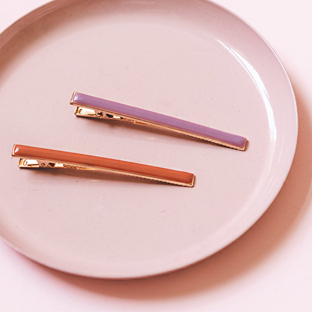 1 lilac & burnt orange Enamel Flat Hair Clip Set. These are the simple hair clips you have been searching for! Mix up what shape and color you use, or pair them both together! Dress up your monochrome style or pair together as surprising colors, either way you have our full fashion support.