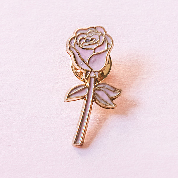 This dainty rose pin is the perfect keepsake you can wear wherever you go. The white one is minimal and precious. Make it your lucky pin! An light pink enamel with gold pin shaped like a rose with a stem and leaves