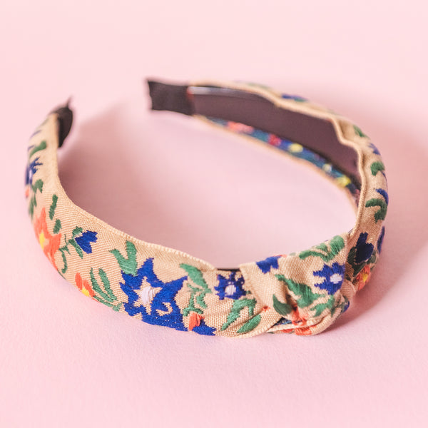 Tan embroidered Headband with blue and orange flowers