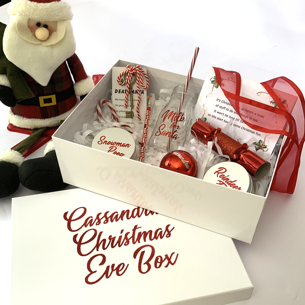 personalised christmas eve bix with santa key, pencil, personalised bauble, personalised good certificate, santa milk bottle, reindeer food, snowman poo, bon bon, cnady cane