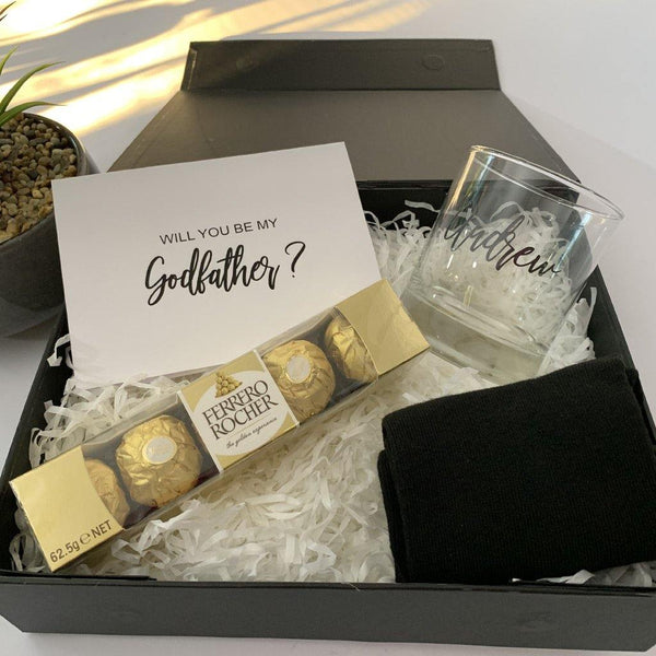 god father gift box that includes chocolates, card, socks etc