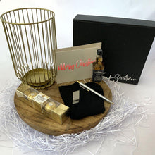 Load image into Gallery viewer, Black gift box, shot glass, alcohol, stainless steel money clip, stainless steel two toned pen, black bamboo socks, ferrero Rocher chocolates, personalised greeting card