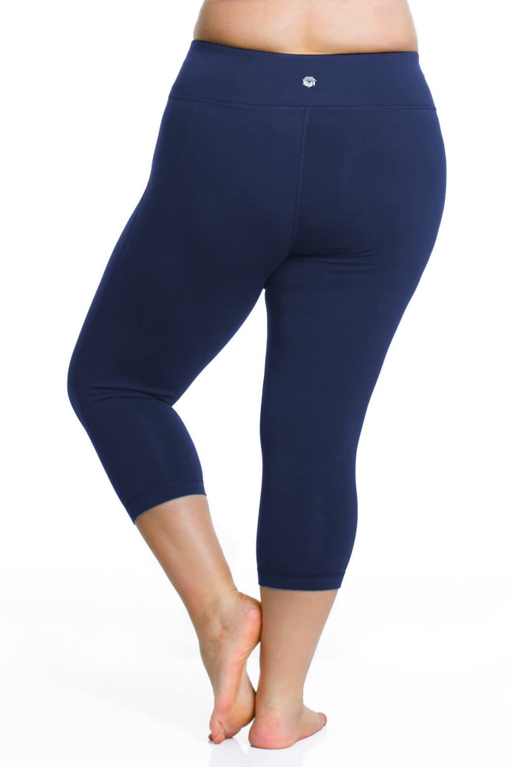 Model is shown from the back wearing navy capri length leggings with pocket