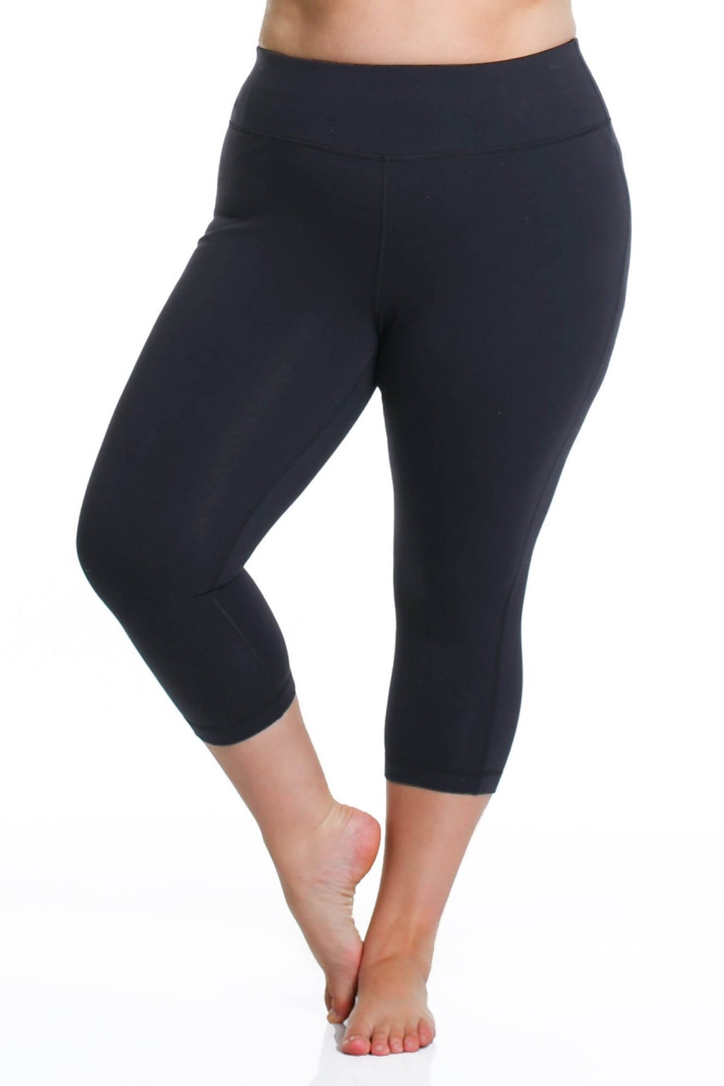 Model is shown from the waist down wearing black capri length leggings.