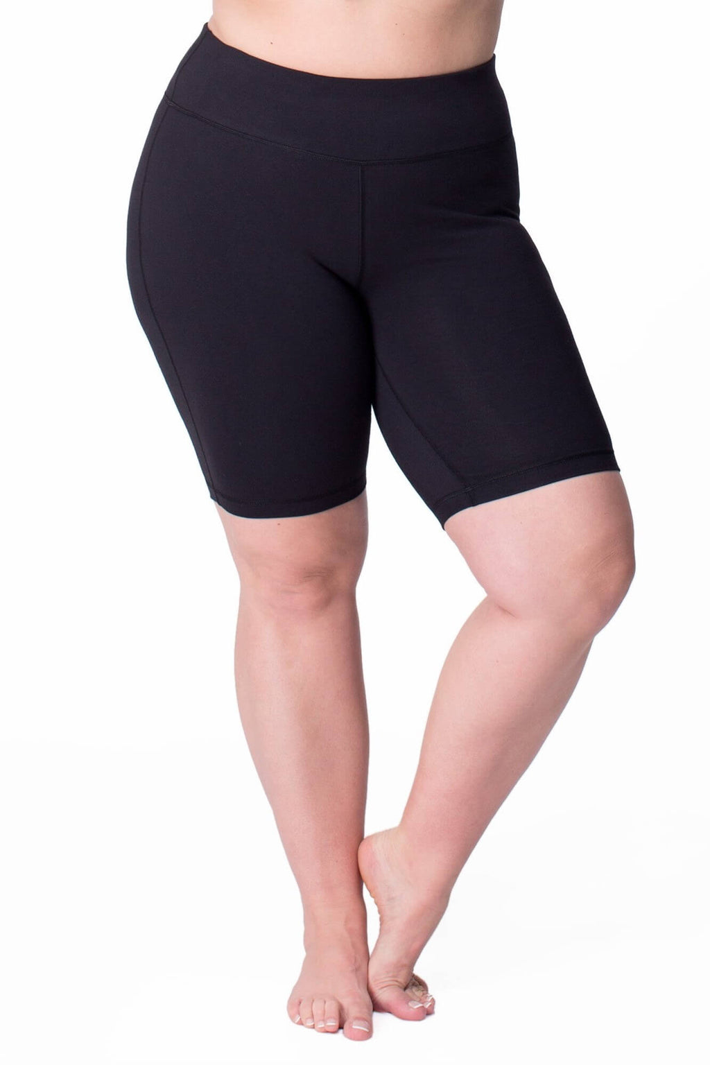 Model shown from the waist down wearing black bike shorts which cut off just above the knee.