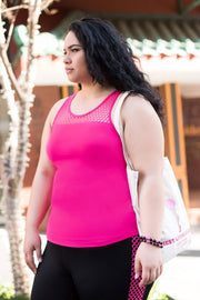 Female model is shown wearing a pink tank top with mesh trim at neckline and shelf bra - tight fitting. Worn with black leggings with a pink checked mesh pattern down the length of each side.