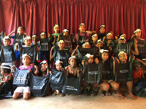 The children of the Damagat tribe in Mount Paliparan Rizal hold their CommonThread Philippines cassava biobags custom made by EcoNest Philippines