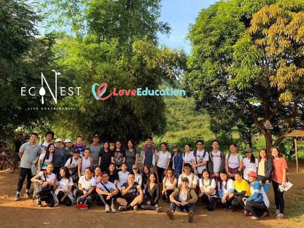 Participants from EcoNest Philippines and Love Education Philippines Future Seeds program smile for the camera at Mount Paliparan Rizal. Group included friends from Love and Light Co, Shangri-La Makati, and Engineering students from De La Salle Dasmarinas.