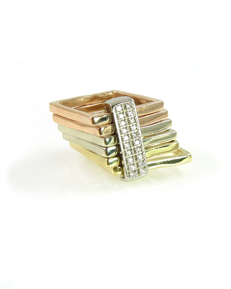 Tri-color gold square rings with sliding diamond bar from the Abacus Collection, by Nan Fusco.