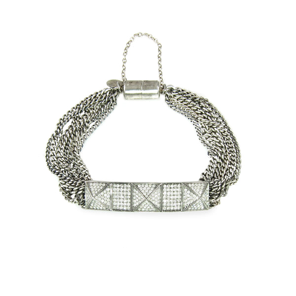 A beautiful bracelet with diamond pyramids with curb chains and magnetic clasp.