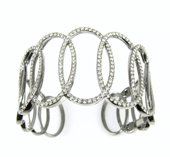 Statement bracelet with intersecting diamond ovals in sterling silver.