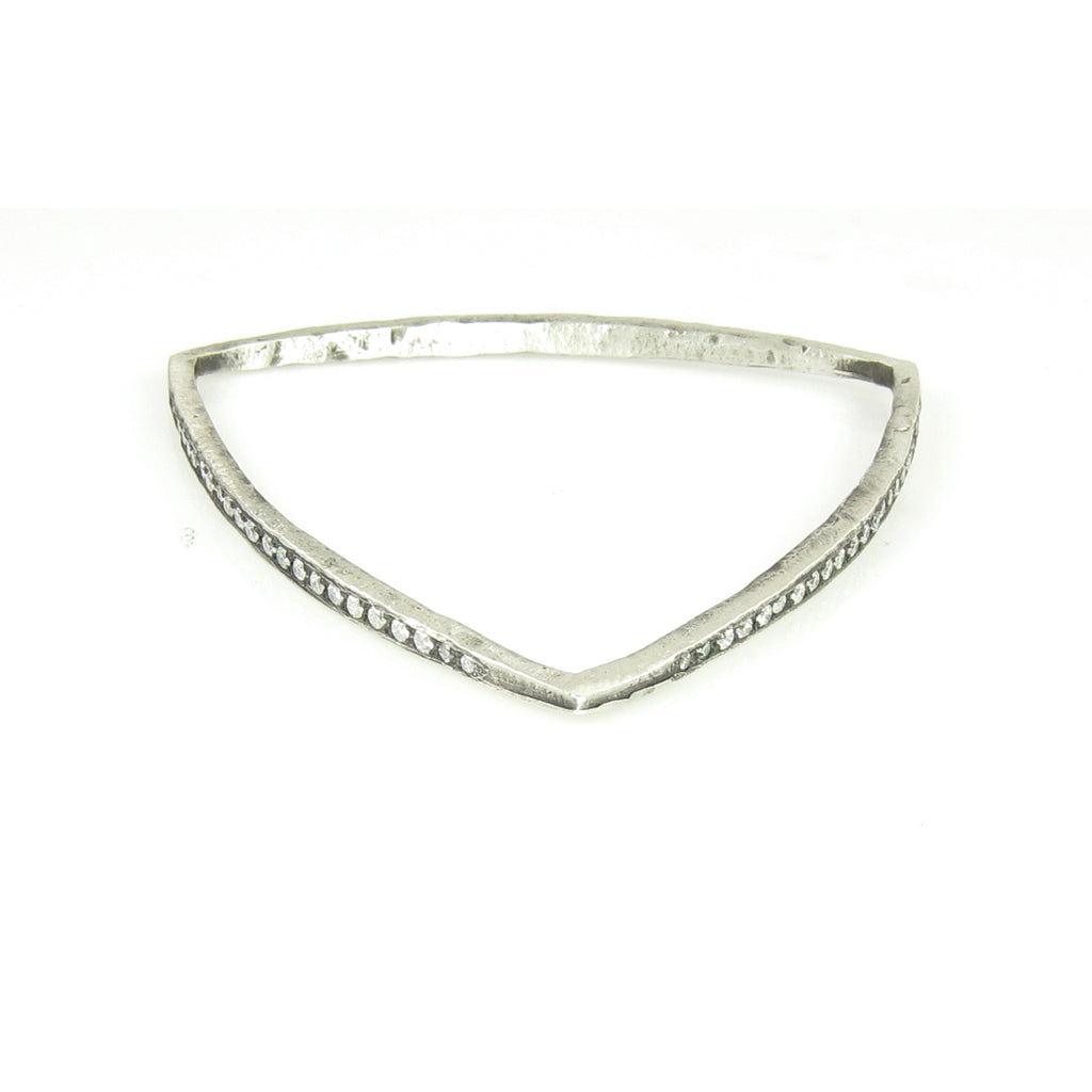 A diamond bangle in the shape of a triangle makes a unique, whimsical statement.