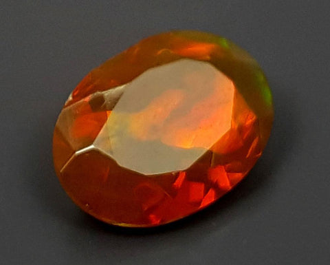 0.79CT FACETED OPAL HIGH FIRE STONE IGCOP06