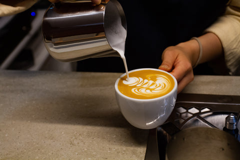 Pouring a latte of our Shadow Boxer Espresso Blend
