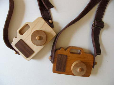 Fact + Fiction Toy Wooden Cameras are handmade in the USA, are available in maple or cherry wood, and are sealed with organic beeswax and olive oil. Sold online at The Eco Baby Co™.