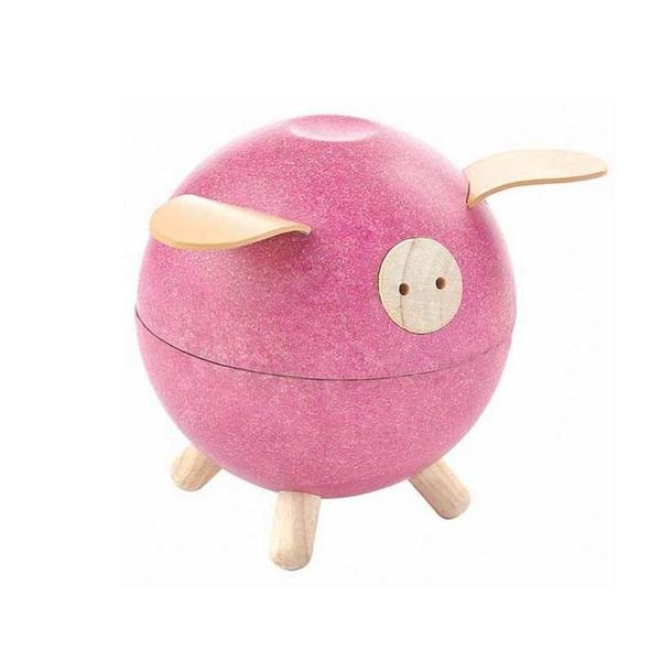 The Plan Toys piggy bank is made from sustainable rubberwood and is ethically made. It will help encourage math & fine motor skills. For children 3+. In pink color.