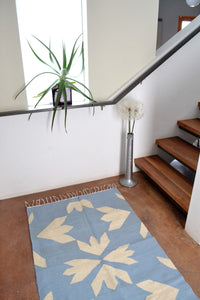 Bloom blue wool kilim accent rug by Yuba Mercantile