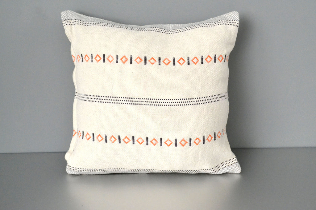 Orange and navy on white cotton throw pillow by Yuba Mercantile