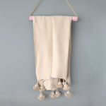 Natural Moroccan Cotton Pom Pom Throw from Yuba Mercantile