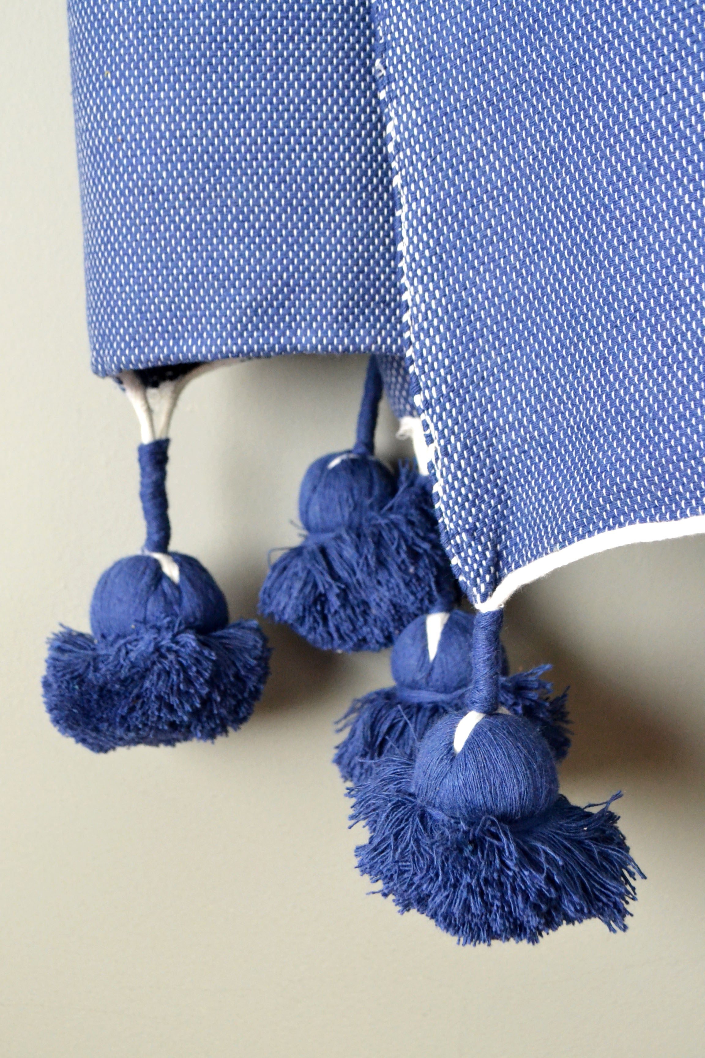 Navy Cotton Pom Pom Throw Blanket from Yuba Mercantile