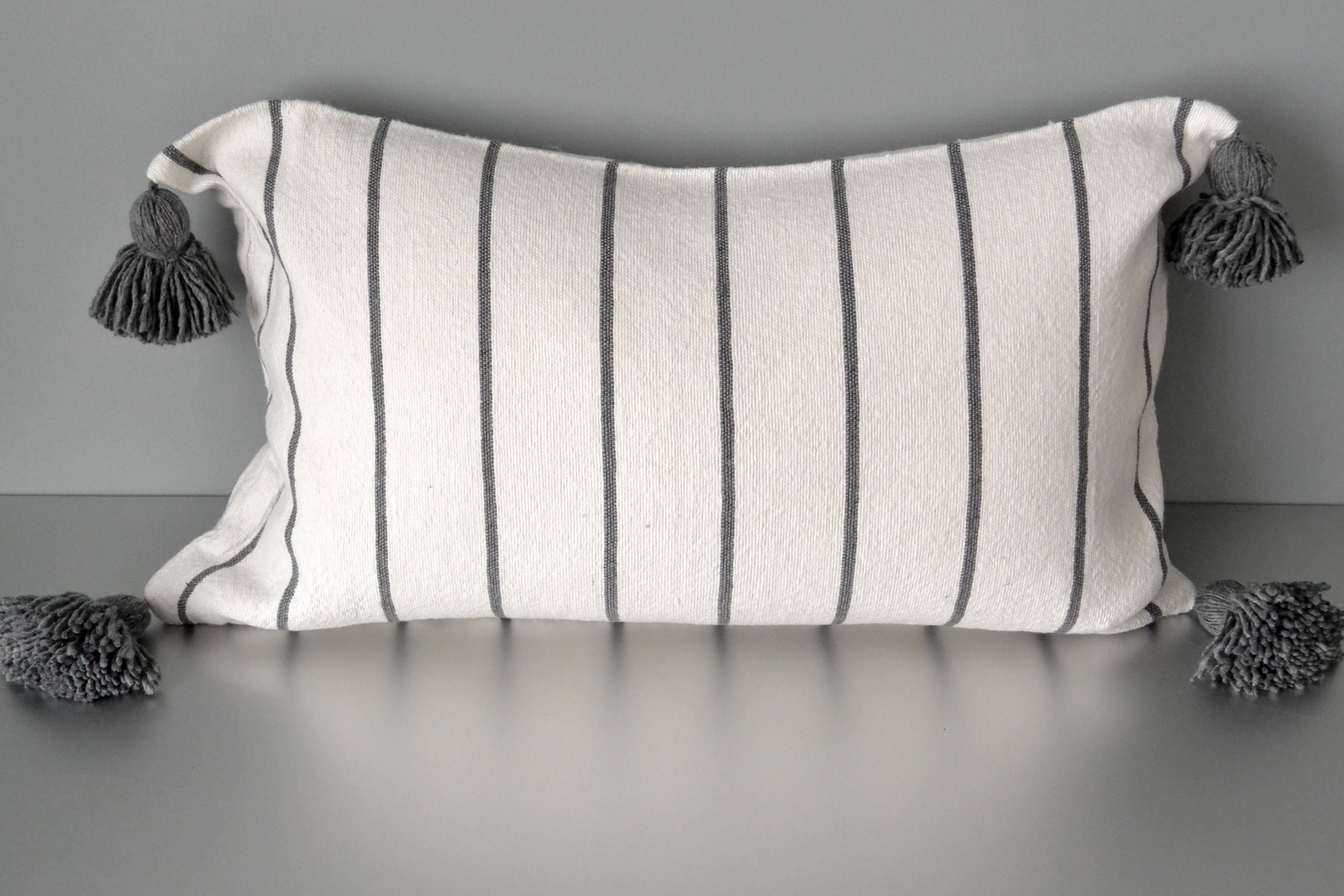 Steel Gray Striped Pom Pom Lumbar Pillow by Yuba Mercantile