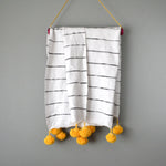 Black and White Striped Moroccan Throw with Golden Pom Poms by Yuba Mercantile
