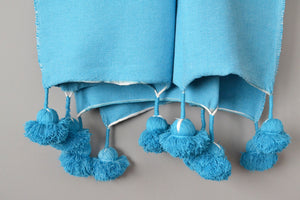 Blue Moroccan Cotton Pom Pom Throw Blanket from Yuba Mercantile