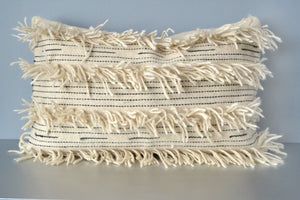 White fringe wool lumbar pillow by Yuba Mercantile