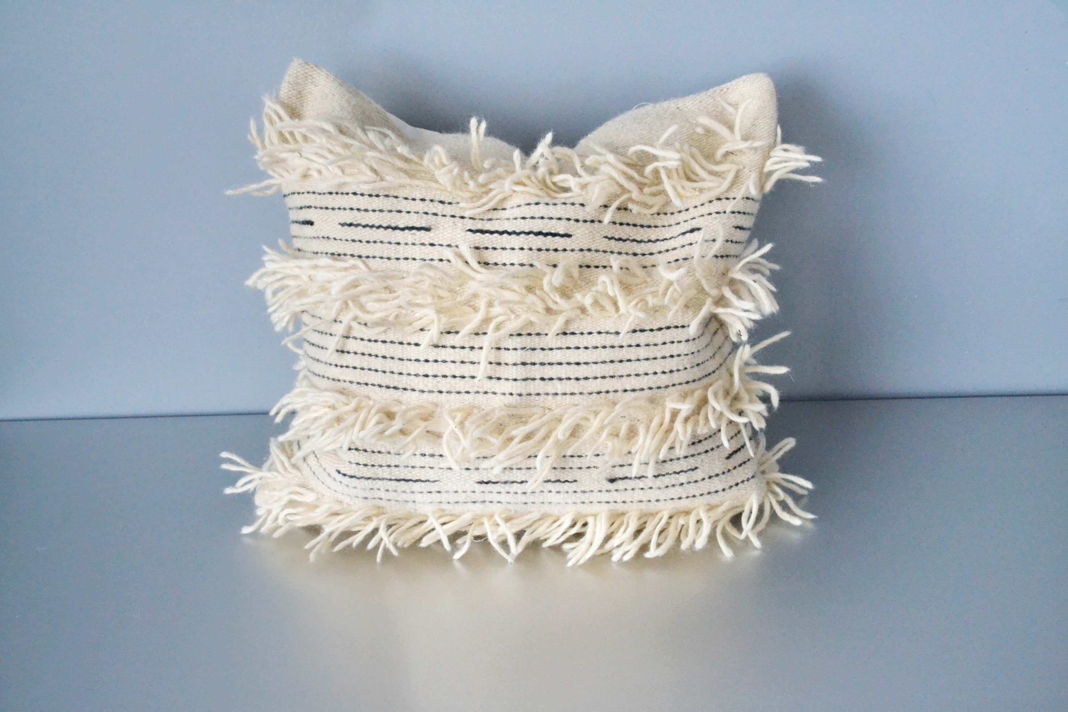 White fringe wool throw pillow by Yuba Mercantile