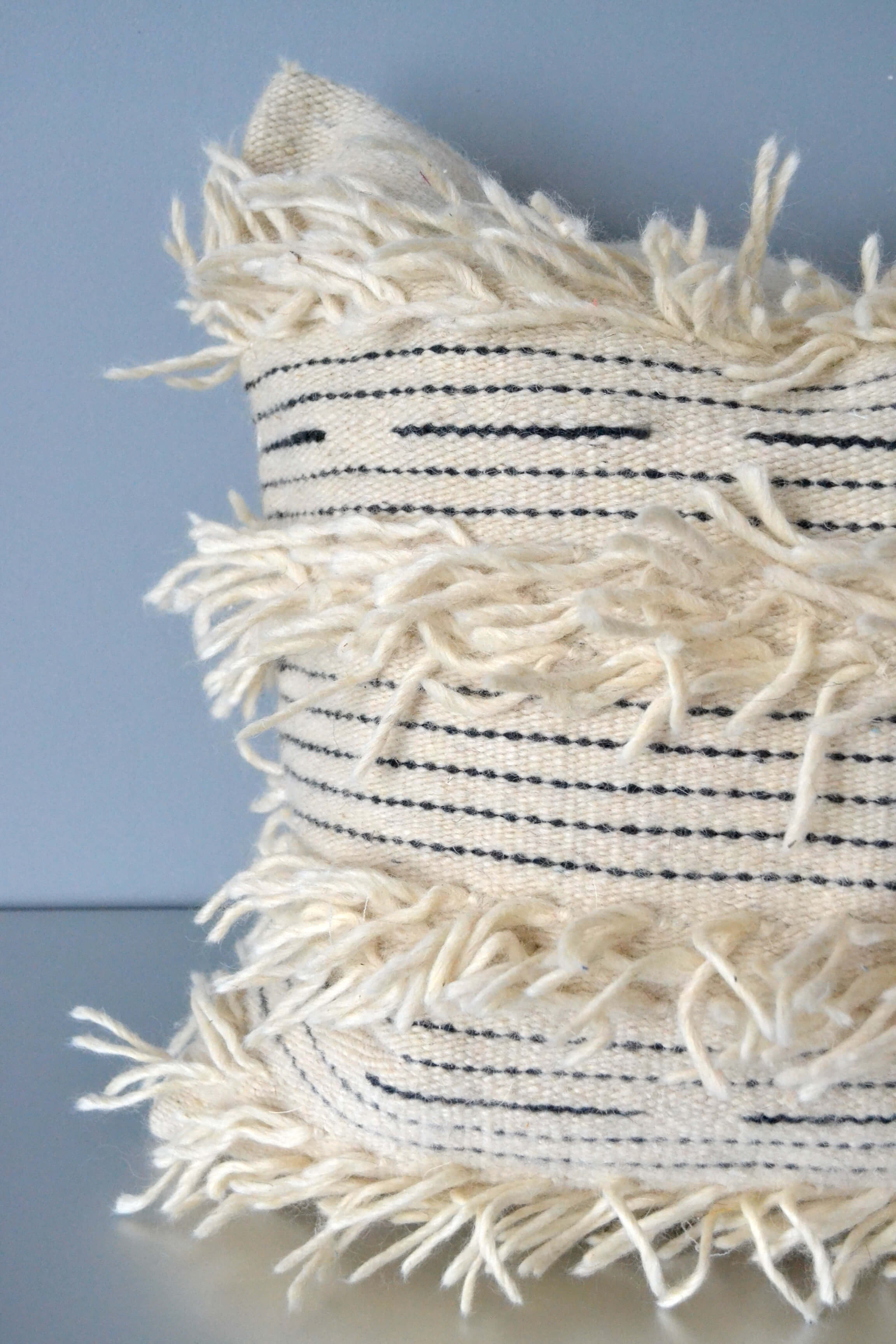 White fringe wool throw pillow closeup by Yuba Mercantile