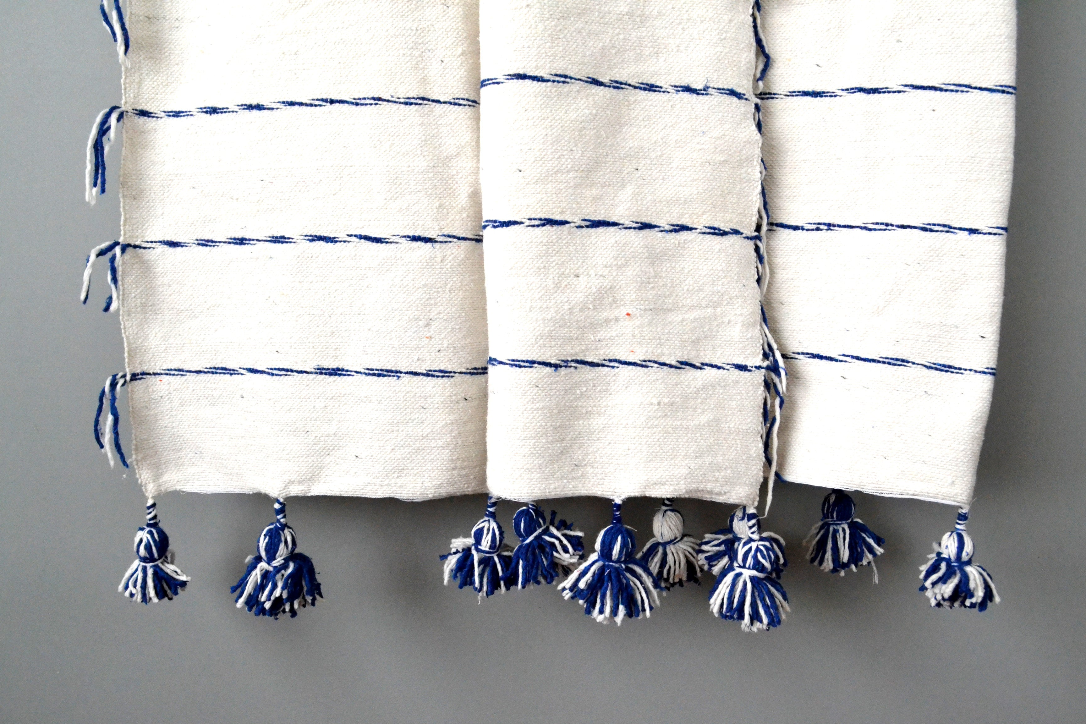 Blue and Ivory Fringe Pom Pom Cotton Throw by Yuba Mercantile